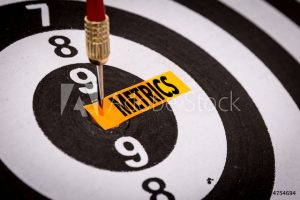 "dart in bullseye of dartboard, with word ""metrics"""